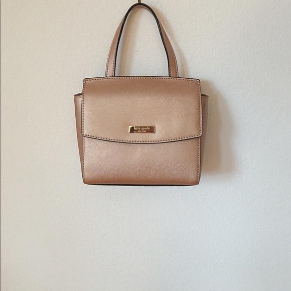 kate spade Handbags - NWT Kate Spade rose gold mini crossbody bag